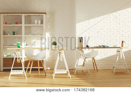 Bright office interior with items on shelves laptop on table other items equipment and sunlight