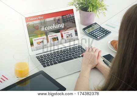 Woman Using Laptop In Home. Culinary Website Blog Concept