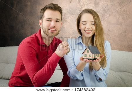 Young Couple Enjoys The Purchase Of Own Home