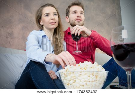 Couple Enjoys Free Time Watching Tv