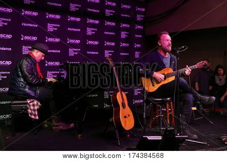 PARK CITY, UTAH-JAN 23: Musicians J. Ralph (L) and Sting perform onstage at the Sundance ASCAP Music Cafe during the 2016 Sundance Film Festival - Day 3 on January 23, 2016 in Park City, Utah.