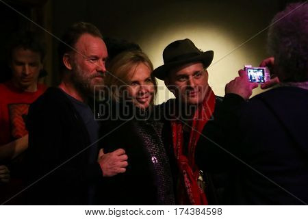 PARK CITY, UTAH-JAN 23: (L-R) Sting, Trudy Styler and J. Ralph pose for pictures at the Sundance ASCAP Music Cafe during the 2016 Sundance Film Festival - Day 3 on January 23, 2016 in Park City, Utah.