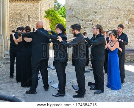 VAISON LA ROMAINE FRANCE - AUGUST 4 2016: Choral singers make a massage of each other before the performance. Relaxation.