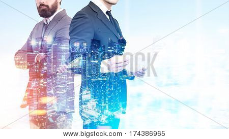 Close up of an unrecognizable business duo. One businessman is holding documents his partner is standing with crossed arms. Night city. Double exposure mock up toned image