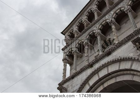 Italy Lucca - September 18 2016: detail exterior view of the fragment of Lucca Cathedral. Cattedrale di San Martino on September 18 2016 in Lucca Tuscany Italy.