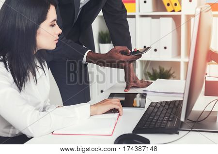 Side View Of Woman In Office And Her Colleague