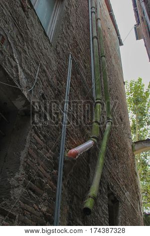 Italy Lucca - September 18 2016: the view of drainage system on Lucca's narrow street San on September 18 2016 in Lucca Tuscany Italy.