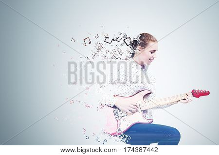 Side view of a girl wearing a white shirt and jeans and playing an electric guitar. She is made of a jigsaw puzzle. Mock up.