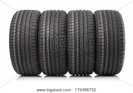 New car tires isolated on white background. Summer tyres.