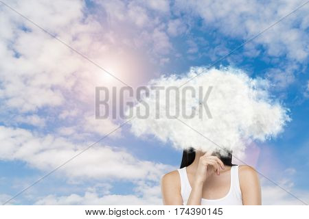 Portrait of a girl wearing a white tank top and standing against a sky background with a cloud covering her head. Mock up.
