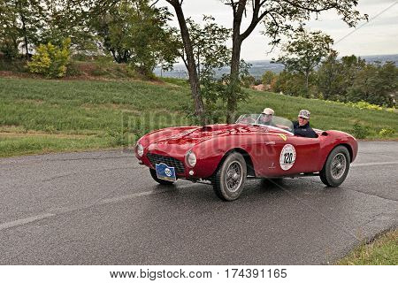 MELDOLA, FC, ITALY - SEPTEMBER 18: driver and co-driver on a vintage racing car Ferrari 375 MM Pininfarina Spider (1953) in classic car rally