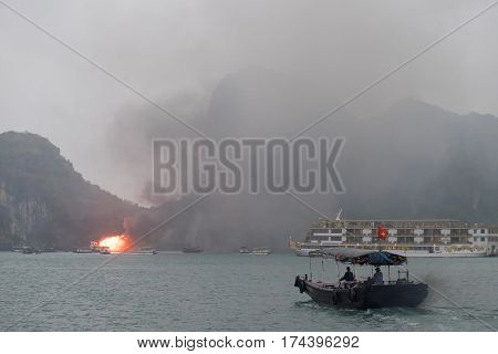 HALONG BAY VIETNAM JAN 10 2017 : Fire burning on the cruise ship in the morning 7:00am at halong bay