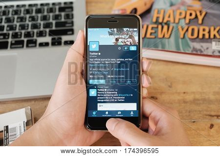 CHIANG MAI THAILAND - JAN 16 2017: A man holds Apple iPhone with social networking service Twitter on the screen. iPhone 6S was created and developed by the Apple inc.