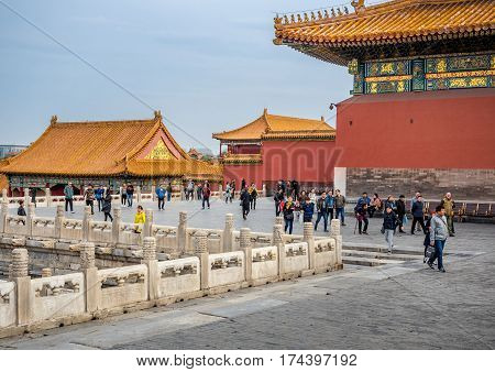 Beijing, China - Oct 30, 2016: Visitors enjoying the views around the Hall of Supreme Harmony (Taihedian). Forbidden City (Gu Gong, Palace Museum).