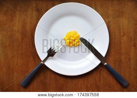Diet. Plate with a limited food on wooden background