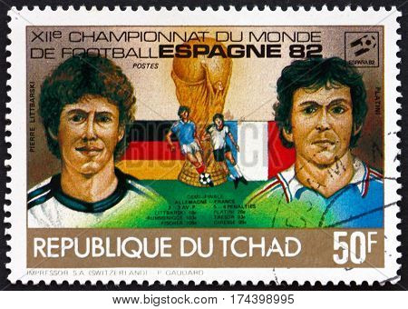 CHAD - CIRCA 1982: a stamp printed in Chad shows Pierre Littbarski and Platini soccer players circa 1982
