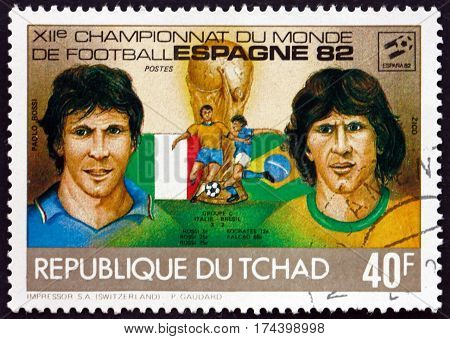 CHAD - CIRCA 1982: a stamp printed in Chad shows Paolo Rossi and Zico soccer players circa 1982