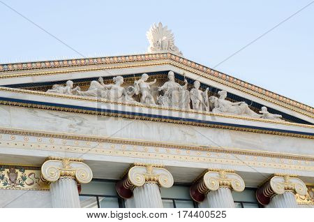 pediment, decorated with marble statues, sculptures, ancient gods columns with virtuoso drawings