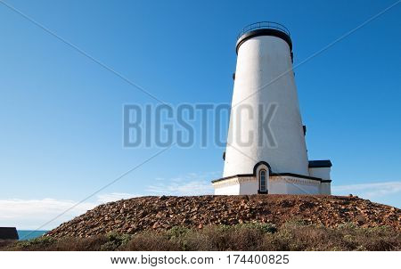 Lighthouse in afternoon sunlight at Piedras Blancas point on the Central California Coast north of San Simeon California USA