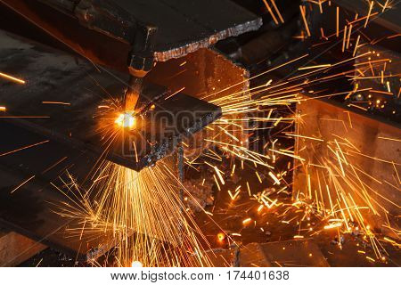 Worker cutting steel beam using metal torch in manufacturing factory, Closeup position cutting.