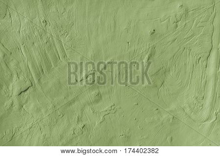 Weathered rugged plastered green painted wall surface texture as background
