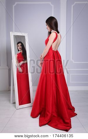beautiful young woman wearing red dress