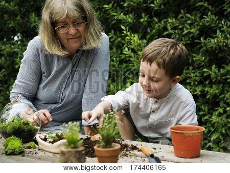 Grandma And Nephew Relax In Garden