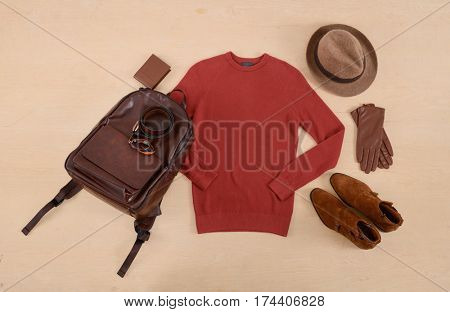 Men's casual outfits with man clothing and accessories on wooden background,