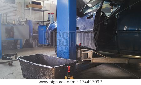 Car service station - dust particles float in the air at sunny midday, horizontal