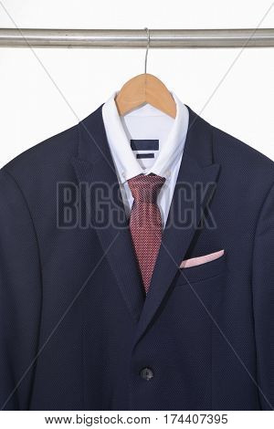 Set of men's suits ,shirt with ties on hanging
