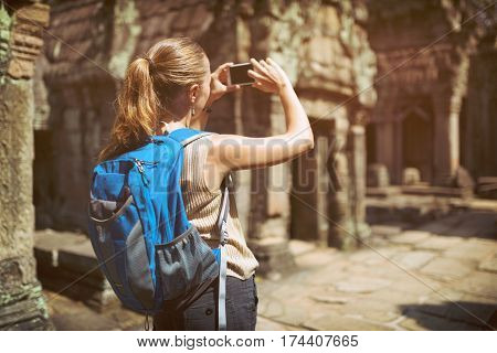 Tourist Photographing In The Preah Khan Temple In Angkor, Cambodia