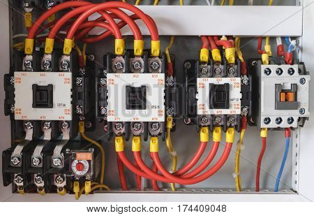 Close-up electrical wiring with fuses and contactors.