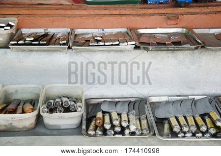 Asian thai people sale many kind of Aranyik knives on wooden shelf for travelers people at Store knives or Knife Shop on January 25 2017 in Ang Thong Thailand