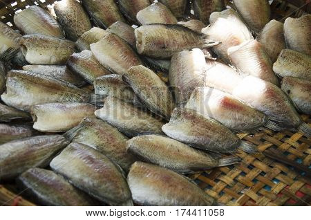Dried raw fish or Gourami fish preserves for sale at local shop in Wat Muang temple in Ang Thong Thailand