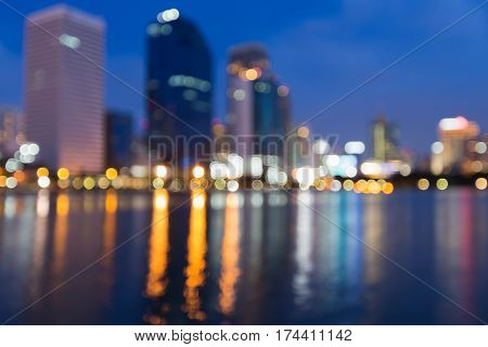 Office building blurred bokeh light with reflection night view abstract background