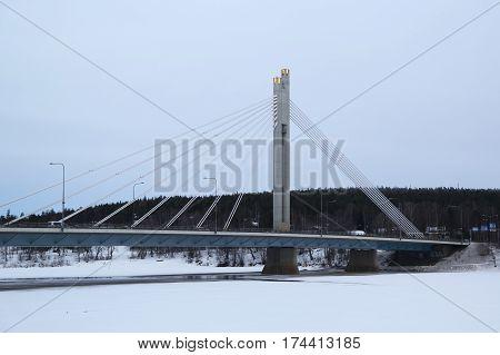 ROVANIEMI, FINLAND - FEBRUARY 17, 2017: The Jatkankynttila bridge or Lumberjack s Candle Bridge over Kemijoki River in Rovaniemi, Finland