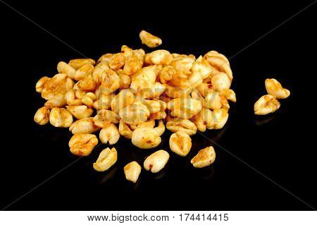A close-up of puffed wheat on a black background