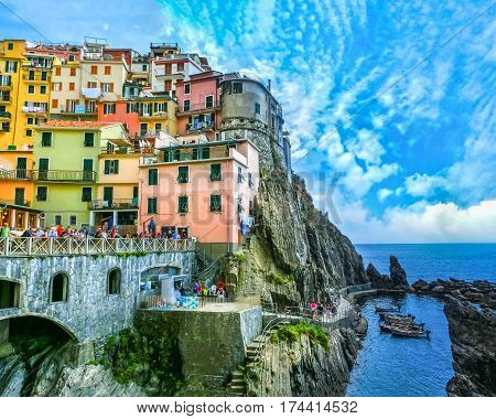 Colorful traditional houses on a rock over Mediterranean sea at Manarola, Cinque Terre, Italy
