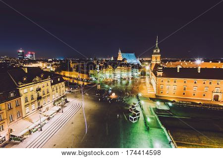 Warsaw, Poland - September 15th, 2016. Polish capital city skyline. Warsaw high view from above. Old town illumination by night. The Royal Castle square, restaurants, Barbican and Sigismund's Column.