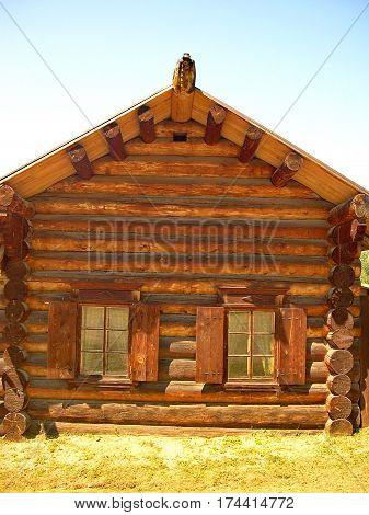 A window with shutters. Log hut facade, fragment. Closeup. Log hut in Siberian village. Lake Baikal, Russia