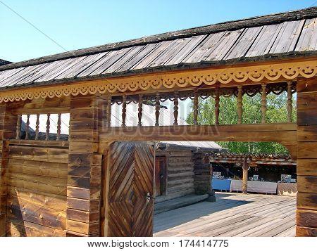 The gate to the courtyard, fragment. Closeup. Log hut in Siberian village. Lake Baikal, Russia