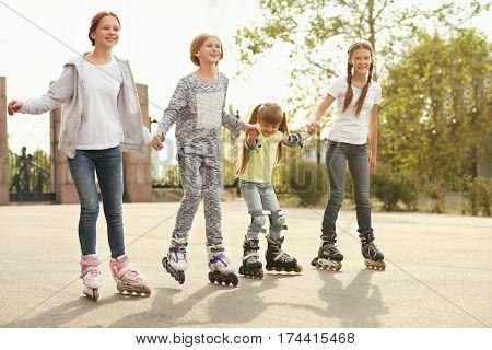 Teenager girls on roller skates in park