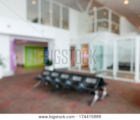 Blurred of waiting room at the airport with the chairs