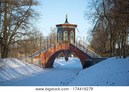 Cross the bridge in the Alexander Park the November snow day. Tsarskoye Selo, Saint Petersburg. Russia