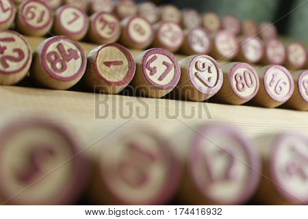 Kegs for game in lotto close up on wooden background