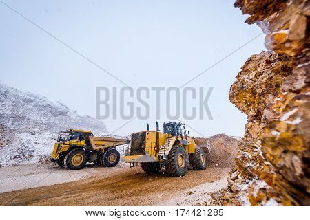 Truck loading. Gold mining at an open pit