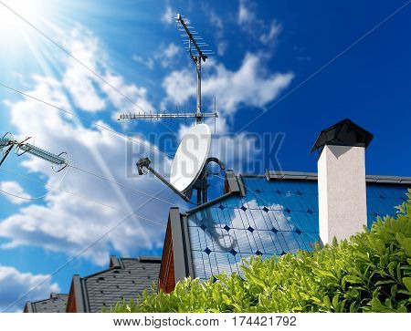 Close-up of a house roof with solar panels and satellite dish with antenna TV on a blue sky with clouds sun rays and a power line