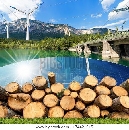 Renewable energies sources - Wind energy (wind turbines) solar energy (solar panels) biomass (tree trunks) and hydropower (dam for hydroelectric power)