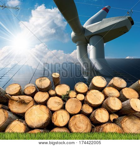 Renewable energies sources - Wind energy with a wind turbine solar energy with a solar panels biomass with a stack of tree trunks