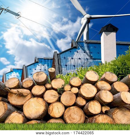 Renewable energies sources - Wind energy (wind turbine) solar energy (roofs of houses with solar panels) biomass (a stack of tree trunks) and a power line